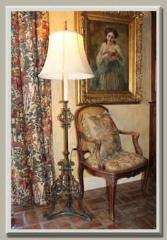 Curtains, beautifully framed arm, lamp, chair, and check out the floor!