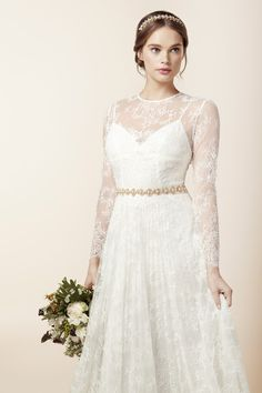 Love the long lace sleeves on this dress!