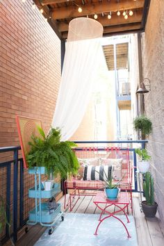 The Look for Less:  Elizabeth's Color-Filled Patio on a Budget - love the rolling cart as plant stand!