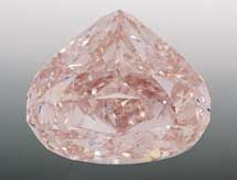 """The """"Pink Sun Rise"""" Diamond is a rare, flawless fancy pink 29.78 carat diamond cut by famed diamond cutter Gabi Tolkowsky.  The diamond's shape is an homage to the famous Centenary Diamond, also cut by Tolkowsky.  Little else is know of this unique gem, including date of discovery, country/mine of origin, etc, other than it was unveiled to the public at the beginning of the 21st century."""