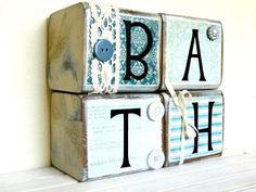 Bathroom wooden sign for the bathroom home decor blue with vinyl lettering and rustic embellishments comes with the four blocks. $28.00, via Etsy.