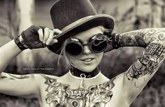 Steampunk tattoo girl - Steampunk comes from science fiction novels and evolves to a fashion style that mixes old and new and reproduces fashion elements with steampunk literature. As a form of artistic representation, it's not surprised artists have found their way to apply the classic style in tattoo designs. Steampunk tattoos are loved by the people who want to add some retro-Victorian elements in their life.
