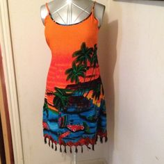 """Swimsuit Cover Up Bright, colorful. Ties in back. Fringe on bottom. Straps are not adjustable. From neckline to fringe 30 1/2"""" bust to 36"""". 100% rayon. Caribbean Surf Swim Coverups"""