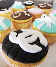 Designer Cupcakes for a fashionista's birthday or bridal shower...  Chanel, Tiffany, Louis Vuitton, Gucci...  Options are endless!