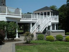Elevated deck leading to a patio ~ Middletown, NJ | Design Build Pros