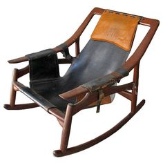 Arne Tidemand Ruud; Teak, Leather and Brass Rocking Chair, 1959.