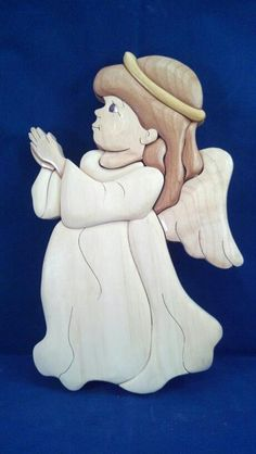 Little Angel Intarsia.  all Natural colors of the wood