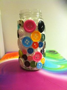 Buttons glued on to a vase