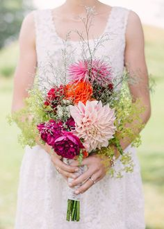 Wild flower wedding bouquet created by the bride. Photography by Hannah Duffy