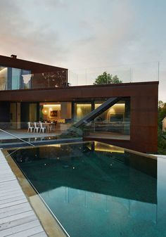 multifaceted design with the use of raw materials create significant views + grass covered roof terrace (highest volume)