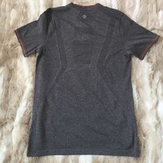Lululemon Men's Shirt EUC Lululemon Men's shirt. Size small but could fit like a women's large. Dark heather gray. Excellent condition. lululemon athletica Tops Tees - Short Sleeve