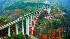 The Beipanjiang River Railroad Bridge in Guizhou, China, ranks with the world's longest arch bridges but stands out due to its spectacular scenic beauty. Love Bridge, High Bridge, Bridge Structure, Hangzhou, Pictures Of Bridges, Train Pictures, Trains, Railroad Bridge, Bridge Design