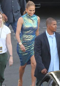 Flattering outfit: J-Lo's dress hugged her famous curves