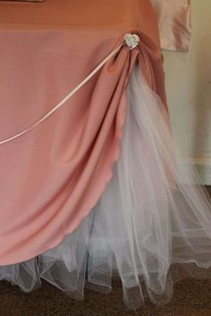Table Party Decor - Give your tablecloth an underskirt of tulle. Raise the tablecloth at the corners, exposing the tulle, and secure with a silk flower, fancy pin or brooch. Swag a thin ribbon from one corner to the other