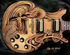 Carved guitar .....