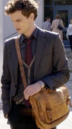 Dr. Reid... only he can look good with a man purse :P