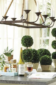 These lush Preserved Boxwood Topiaries are hand made from natural boxwood that's been specially treated to retain its glossy, deep green color and soft texture.