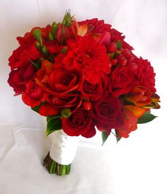 Stunning bouquet of carnations, dahlia, hypericum, roses, freesia, alstromeria and tulips