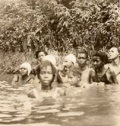 Taking A Swim This is an old photograph of some African American girls enjoying a swim on a Summer day sometime during the 1920's.