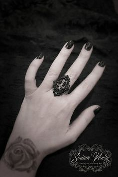 http://www.etsy.com/listing/130378384/gothic-cross-ring-ornate-black-cameo?ref=shop_home_active