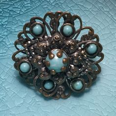 Vintage Turquoise Brooch This was my momma's when she was in her 20's. Absolutely gorgeous and in great condition. It is about the size of a quarter, maybe just a hair bigger. Jewelry Brooches