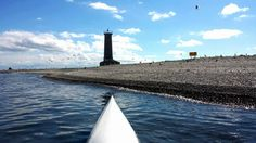 Becky slides her Epic surf ski up to the beach at Mohawk Island on Lake Erie...