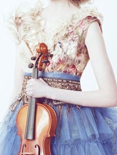 The violin is an excellent accessory to spice up your evening couture.