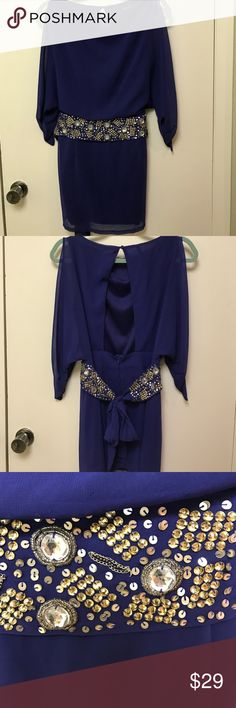 Like new boutique Open back short dress Dress up in glam. Open back and arms. Length approx 30 inches. This pairs great with the Nine West gold stiletto pumps (size 8) that are in my closet. Ask about a bundle discount! ark and co Dresses Mini