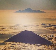 Mt Agung (Bali) with Mt Rinjani (Lombok) behind at sunrise from the air
