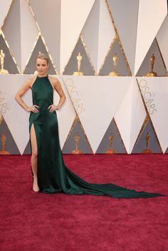 Rachel McAdams wears an August Getty Atelier gown with a major train and open back, plus a Salvatore Ferragamo clutch, Stuart Weitzman heels and Piaget drop earrings. (Oscars 2016)
