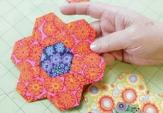 Create precise shapes when you learn the English Paper Piecing quilting technique, where fabric is wrapped around paper pieces. The design possibilities are endless because the shapes align beautifully. Liza shows you how to piece a hexagon shape, but the same principles apply when you work with...