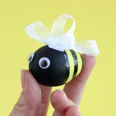 Make some adorable bees out of your leftover Easter eggs! They make fun embellishments for a wreath or any other spring decor.
