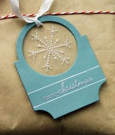 using acetate + white embossing powder to add pizzazz to an otherwise simple tag (though i luv that shape)