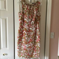 Boden Limited Edition Dress Beautiful Boden Limited Edition dress with bronze appliquéd neckline. This is a perfect dress for an evening out or a wedding. It is a US size 6/UK 10. Boden Dresses Midi