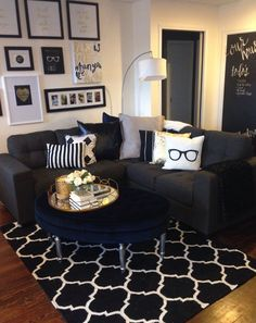 Mini living room re-do! Classic black, white, and gold with pops of navy. Gallery wall & large velvet tufted ottoman add some cute finishes. So happy with all we did on a $500 budget. [Decor from Homesense, Urban Barn, and Target]