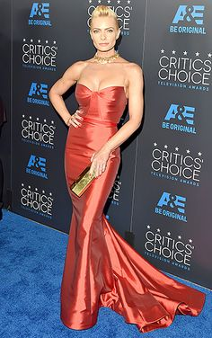 The Mom actress, Jaime Pressly, showcased her curves in a blood orange Gustave Cadile dress with a fishtail hemline.