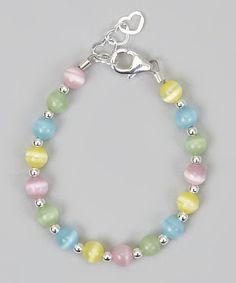 Este Adorable pulsera se hace con multi color gatos ojos perlas, separadores de grano de plata esterlina y plata extensores para crecer con la mano del niño. Esta pulsera se verá como 1 millón por parte del bebé. Las perlas se encadenan en 49 hebras de alambre de la joyería. Cada