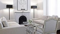 Suzie: Style at Home  Monochromatic living room design with soft gray modern sofas, gray French ...