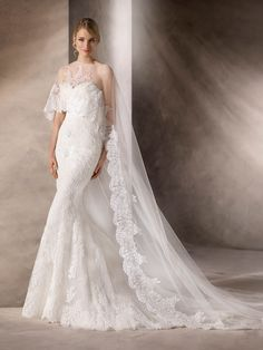 HAYDEN is a fantastic mermaid wedding dress with sweetheart neckline and intricate work in tulle, embroidered tulle, lace, guipure and gemstones