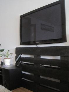 DIY Pallet TV Stand Ideas | 99 Pallets  Note: I think if you do this a good idea would be to put some hanging candles or paint the pallet into a design so it looks more decorative.
