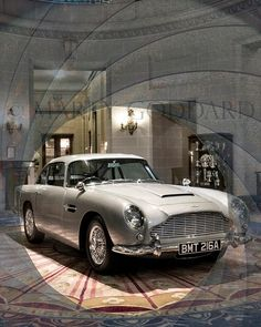 Playboy Bunnies over an Aston Martin British Motor Show 1965 Poster