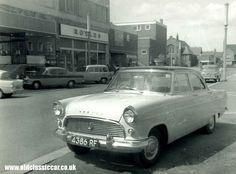 Ford Consul Dads was white and had little peaks over headlights to shade them