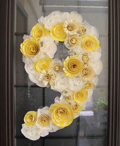 This can be done with cupcake wrappers...a great idea (and cheap) for wedding/party decor