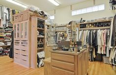 Large, divided walk-in closet // Jewelry stooge in the island, built-ins, shoes storage