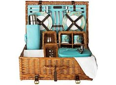 4 person Picnic Hamper from Fortnum & Mason. Complete with real China and monogrammed tablecloth & napkins.That's one fancy picnic!