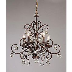@Overstock - This stylish chandelier features several round hanging crystals to capture and reflect the warm light. The chandelier is highlighted in dark amber to blend in with your living space decor.http://www.overstock.com/Home-Garden/Wrought-Iron-and-Crystal-5-light-Chandelier/3285774/product.html?CID=214117 $174.99