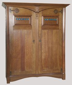 John Ednie - For Wylie and Lochhead - Wardrobe. Oak, Brass & Enamel. Glasgow, Scotland. Circa 1900.