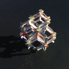 Rhombic dodecahedra. Space tiling. 3D tessellation of space with up cycled milk boxes.