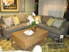 """The Julienne three piece sectional in gray with nailhead trim and a mix of patterned accent pillows. Beautiful! Ideal for a transitional style home. Love the straight, clean lines. 100""""long x 100""""wide x 36""""high."""