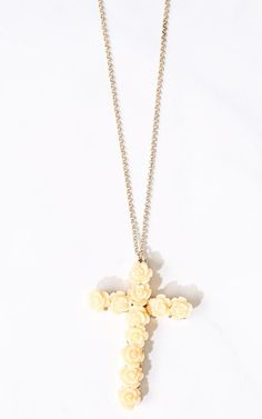 Single chain necklace featuring a cross pendant with acrylic roses. Lobster clasp closure. Lightweight.Approx. 17